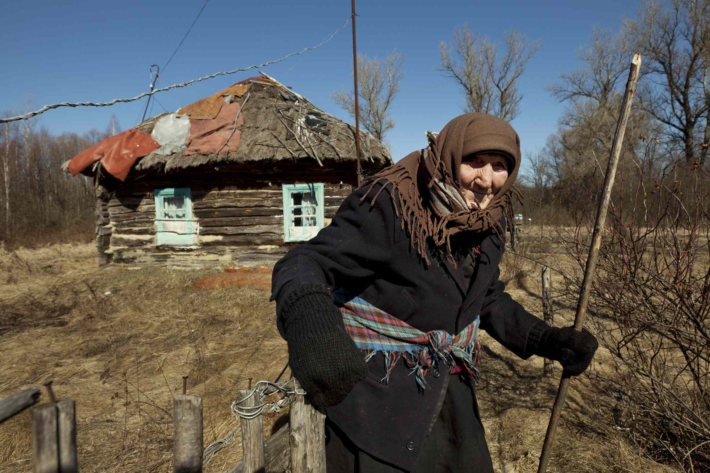 92year-old Kharytina Descha is one of the few elderly people who have returned to their village homes inside the Exclusion Zone. Although surrounded by devastation and isolation, she prefers to die on her own soil As she has difficulties walking and hearing she does not have much communication with anybody in the village but seems to be quite content with her situation.  Background: After the catastrophe, close to 100.000 inhabitants who lived in villages inside the 30km Zone were evacuated. Ignoring radiation levels, a (now diminishing) number of elderly people have returned to their homes. Although surrounded by devastation and isolation, they prefer to die on their own soil than of a broken heart in anonymous city suburbs. At first Ukrainian officials discouraged them, but soon they turned a blind eye.